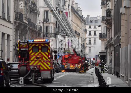 Paris, France. 12th Jan, 2019. Firefighters work at a blast site in Paris, France, Jan. 12, 2019. A gas blast hit Central Paris on early Saturday, leaving several injured, according to local media reports. Local media also reported that the explosion took place in a bakery on the Rue de Trevise in the ninth arrondissement of Paris. Credit: Chen Yichen/Xinhua/Alamy Live News - Stock Photo