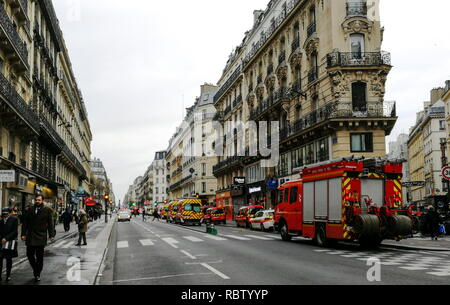 Paris, France. 12th Jan, 2019. PARIS, FRANCE - JANUARY 12, 2019: Emergency services at the scene of a gas explosion in a bakery at the Rue de Trevise Street in the 9th Arrondissement of Paris; fire fighters had arrived at the Rue de Trevise Street before the explosion, in response to a gas odour call; several fire fighters have been injured in the blast, according to French mass media reports. Dmitry Orlov/TASS Credit: ITAR-TASS News Agency/Alamy Live News - Stock Photo