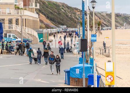 Bournemouth, Dorset, UK. 12th January 2019. People wrapped up warm walk on the promenade in Boscombe in Bournemouth. Credit: Thomas Faull/Alamy Live News - Stock Photo