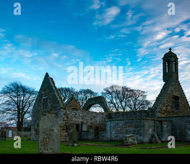 Gladsmuir, East Lothian, Scotland, United Kingdom, 12th January 2019. UK Weather: Clouds sweep across the sky on a windy day at sunset at the ruins of  17th century Old Gladsmuir Parish Kirk and gravestnes in churchyard - Stock Photo