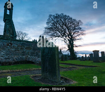 Gladsmuir, East Lothian, Scotland, United Kingdom, 12th January 2019. UK Weather: Clouds sweep across the sky on a windy day at sunset at the ruins of  17th century Old Gladsmuir Parish Kirk and gravestones in churchyard - Stock Photo