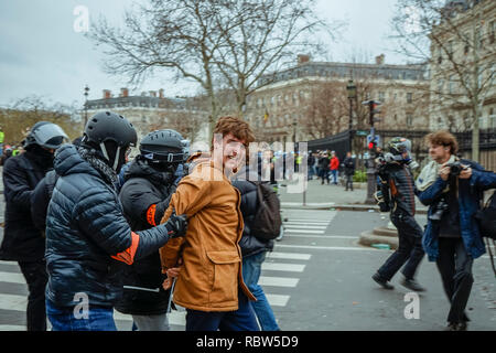 Paris, France. 12th Jan 2019.Thousands of yellow vests (Gilets Jaunes) protests in Paris calling for lower fuel taxes, reintroduction of the solidarity tax on wealth, a minimum wage increase, and Emmanuel Macron's resignation as President of France. Credit: Norbu Gyachung/Alamy Live News. - Stock Photo