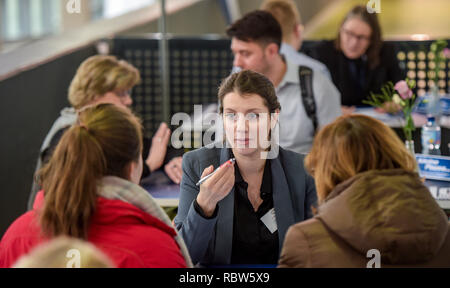 Hamburg, Germany. 12th Jan, 2019.12 January 2019, Germany (German), Hamburg: Visitors to the Hamburg Job Fair can seek advice on their career aspirations in the exhibition hall at the cruise terminal in Altona. The start of the job fair tour through Germany will take place with 70 exhibitors on 12 and 13 January in Hamburg. Photo: Axel Heimken/dpa Credit: dpa picture alliance/Alamy Live News - Stock Photo