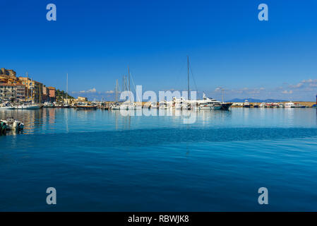 View of harbor seafront in seaport town Porto Santo Stefano in Monte Argentario. Tuscany. Italy - Stock Photo