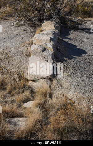 Geology formation of a dike of different rock inside a larger slab of rock - Stock Photo