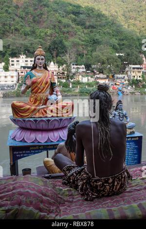 A sadhu (holy man) on the Rishikesh, India, Ganges Rive gaths - Stock Photo