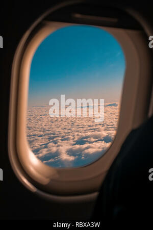 View of clouds from an aircraft window - Stock Photo
