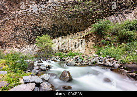 Basalt rock formations known as Symphony of stones, in Garni gorge and Azad river near the town of Garni, in Armenia - Stock Photo