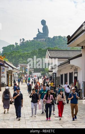 Ngong Ping village overlooked by the Tian Tan Buddha, Lantau Island, Hong Kong - Stock Photo