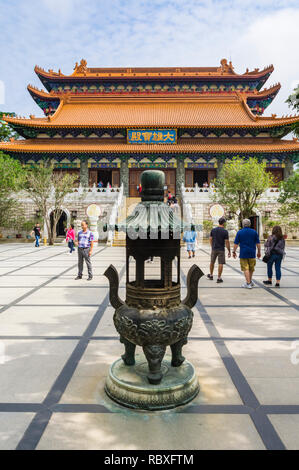 Incense urn at the Po Lin Monastery, Lantau Island, Hong Kong - Stock Photo