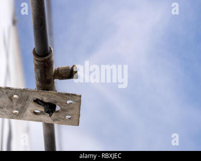 Fastening to the wall of the building with a water mist cooling system nozzle - Stock Photo