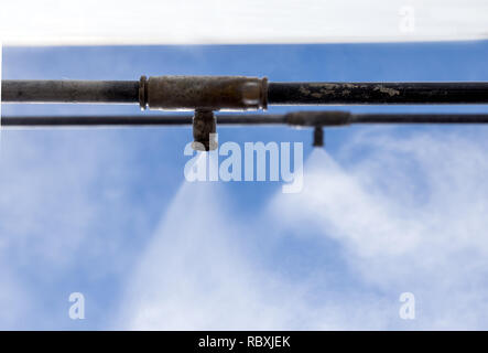 The work of the new cooling system with water mist - Stock Photo