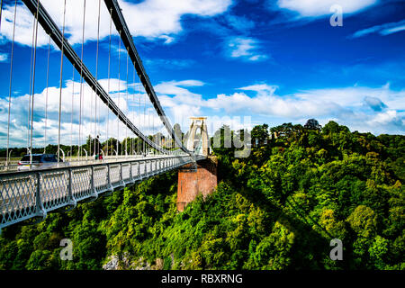 The iconic Clifton Suspension Bridge, taken from the Bristol-side of the Avon Gorge, facing towards Leigh Woods, on a beautiful Spring day. - Stock Photo
