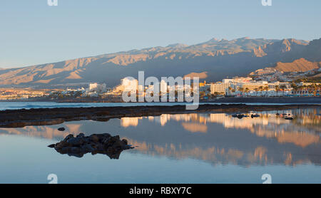 Early morning light over the south-west coast of the island, towards the most popular resorts in Costa Adeje for entertainment, Las Americas, Tenerife - Stock Photo