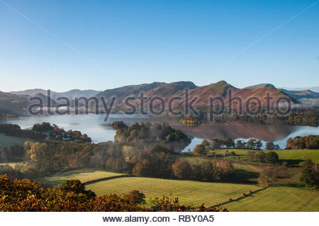 Derwent Water, Lake District in the morning and Autumn colours with cloud inversion - Stock Photo
