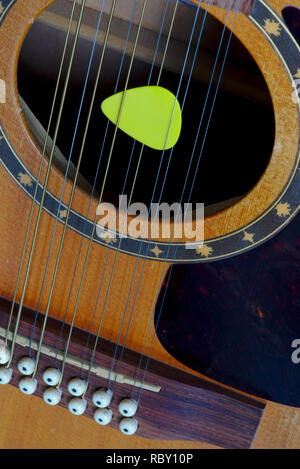 12-string electro-acoustic guitar, and pick, detail, violin making Stock Photo