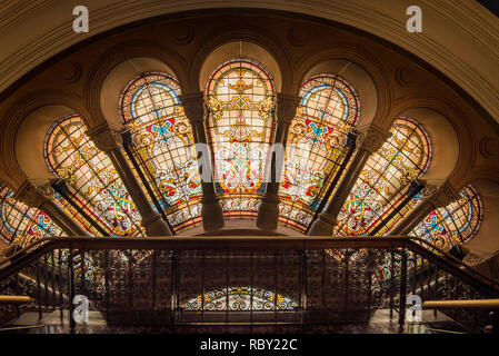 An interior view of stained glass windows on the Western side of the Queen Victoria Building, known locally as simply the QVB, in Sydney Australia - Stock Photo