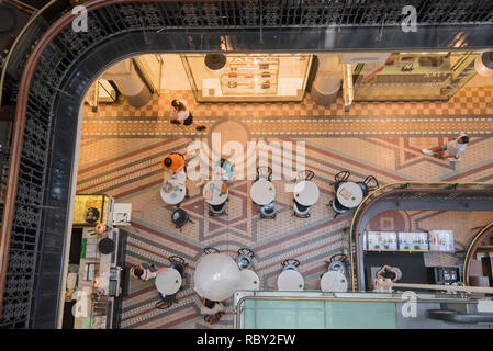 Looking down on patrons at a coffee shop inside the Queen Victoria Building, known locally as simply the QVB, in Sydney Australia - Stock Photo