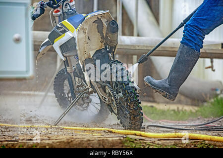 A man cleaning motorcycle - motorcycle detailing concept. Selective focus. - Stock Photo