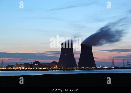 A large nuclear power plant near a river in Belgium. - Stock Photo