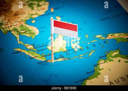 Indonesia marked with a flag on the map - Stock Photo