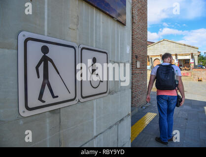 Mtskheta, Georgia - Sep 26, 2018. Public restroom signs with a disabled access symbol on main square in Mtskheta, Georgia. - Stock Photo