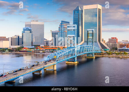Jacksonville, Florida, USA downtown skyline at dusk over St. Johns River. - Stock Photo