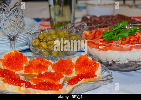 Red caviar and parsley sandwiches on New Year's table for a snack - Stock Photo