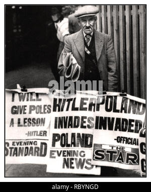 HITLER POLAND INVASION VINTAGE SEPTEMBER 1939 UK NEWSPAPERS HITLER INVADES POLAND  British newspaper seller and posters with news headlines that the Nazis have invaded Poland which started World War II.      Location: London, UK Date: September 1, 1939 - Stock Photo