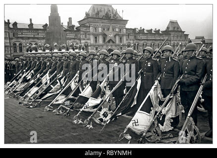 """Vintage Post WW2 image of The Victory Parade on Red Square in Moscow. Soviet Red Army soldiers with defeated fighting banners of the Nazi troops. This Victory Parade ended in the formation of Soviet troops carrying captured 200 combat banners of the defeated Nazi Army. These banners under playing of drums were thrown on a special platform near the foot of Lenin's Mausoleum. The flag of the SS division """"Leibstandarte SS Adolf Hitler"""" was thrown first. Red Square Moscow, USSR Date: 24 June 1945 - Stock Photo"""