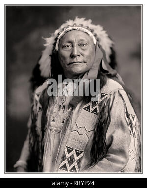 Archive North American Native Tribal Leader HOLLOW HORN BEAR Hollow Horn Bear (1850 – 1913)  a Brulé Lakota leader, who fought in a number of battles, including that at Little Big Horn. He later testified before the US Supreme Court in the case of Ex parte Crow Dog, rode in the inaugural parades of presidents Roosevelt and Wilson, and was featured on the five dollar bank note and a 1922 US postage stamp. - Stock Photo