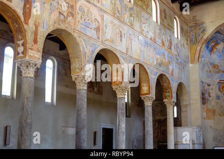 The church 'Sant'Angelo in Formis' is of particular historical value and was built in the 11th century. Here, you see columns and impressive frescos. - Stock Photo