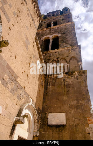 This is a low angle view on the bell tower of the cathedral of Casertavecchia, a romanesque masterpiece in the region of Campania. - Stock Photo