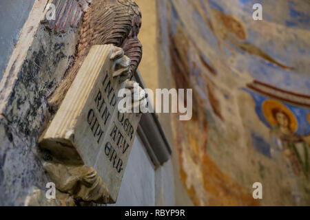 The basilica of 'Sant'Angelo in Formis' is of particular historical value and on behalf of frescos, has sculptures like this one of an open bible. - Stock Photo