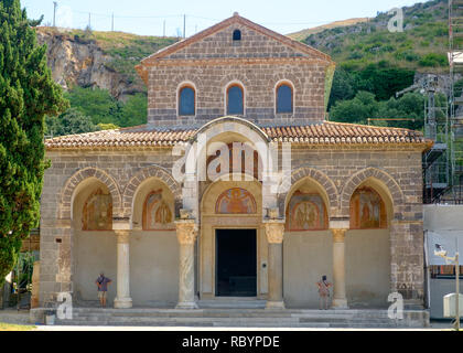 Two people are admiring the facade of the basilica of 'Sant'Angelo in Formis', a hidden treasure in the Italian region of Campania. - Stock Photo