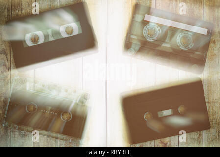 Old cassette tapes with a wooden background - Stock Photo