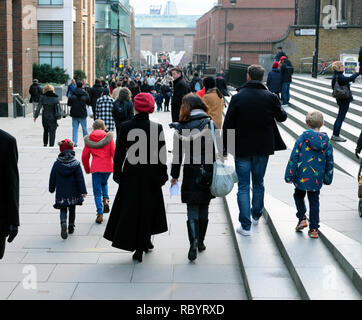Tourists view of people walking from St Pauls to the Millennium Bridge and Tate Modern Art Gallery in December winter Central London UK  KATHY DEWITT - Stock Photo
