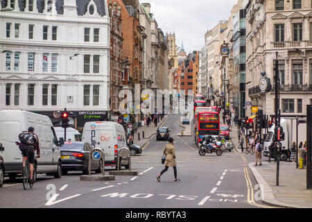 People on Ludgate Hill, looking towards Ludgate Circus and Fleet Street, City of London, UK - Stock Photo