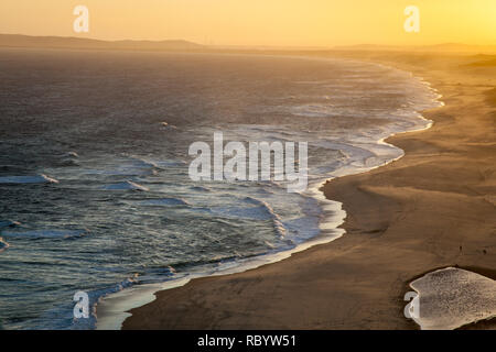 Sunset across the waves at Red Head Beach - Newcastle Australia - Stock Photo
