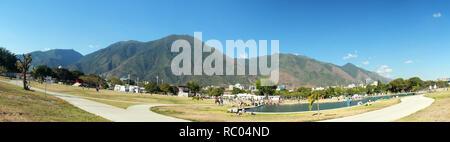 Panoramic view of Cerro El Avila National Park in Caracas Venezuela as seen from Simon Bolivar Park with lake - Stock Photo