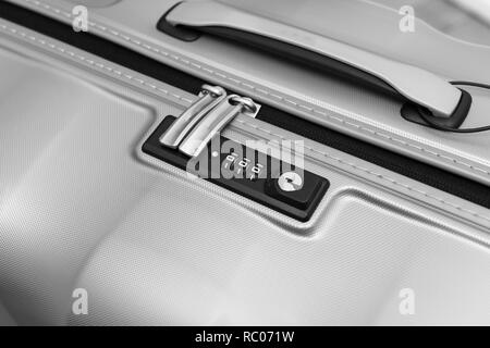 Closeup detail of a suitcase briefcase with focus on  combination lock password number  - Stock Photo