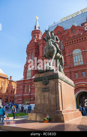 Moscow, Russia- 20 September 2014: Monument of Georgy Zhukov on the horse, Soviet Red Army General. Building of the State Historical Museum in the bac - Stock Photo