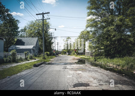 Detroit, Michigan, May, 2018: Abandoned and damaged single family home near downtown Detroit. Photo taken in the USA. - Stock Photo