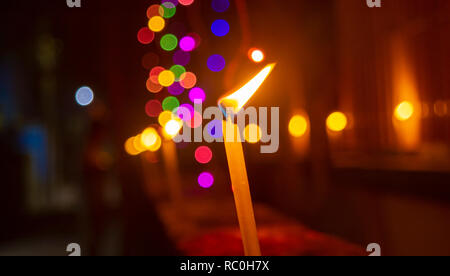 Burning candle light abstract background in night