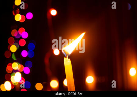 Burning candle With blurred motion light on background