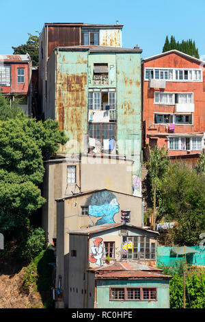 Housing clinging to the hillside in the city of Valparaiso, Chile. - Stock Photo