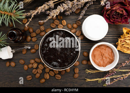Aromatic botanical cosmetics. Dried herbs flowers mixture, aromatic homemade scrub paste made from coffee grounds and oils. Holistic herbal DIY skinca