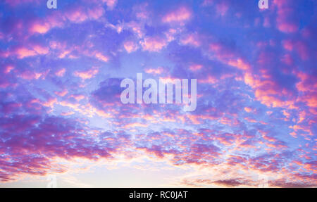 beautiful summer landscape with sunset. purple scenery with clouds in sky, panoramic view - Stock Photo