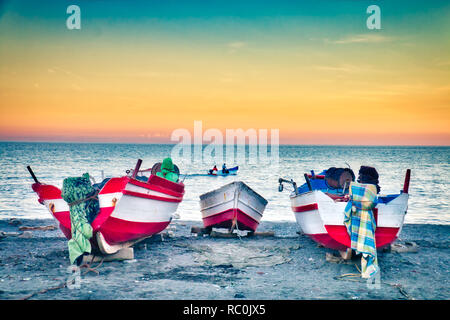Nice sunset with fishing boats on the beach of Oued Laou, in the province of Chaouen, a traditional fishing village on the Mediterranean coast of Moro Stock Photo
