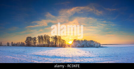 beautiful winter landscape panorama with sunrise. panoramic view with a field of sunshine and blue sky - Stock Photo